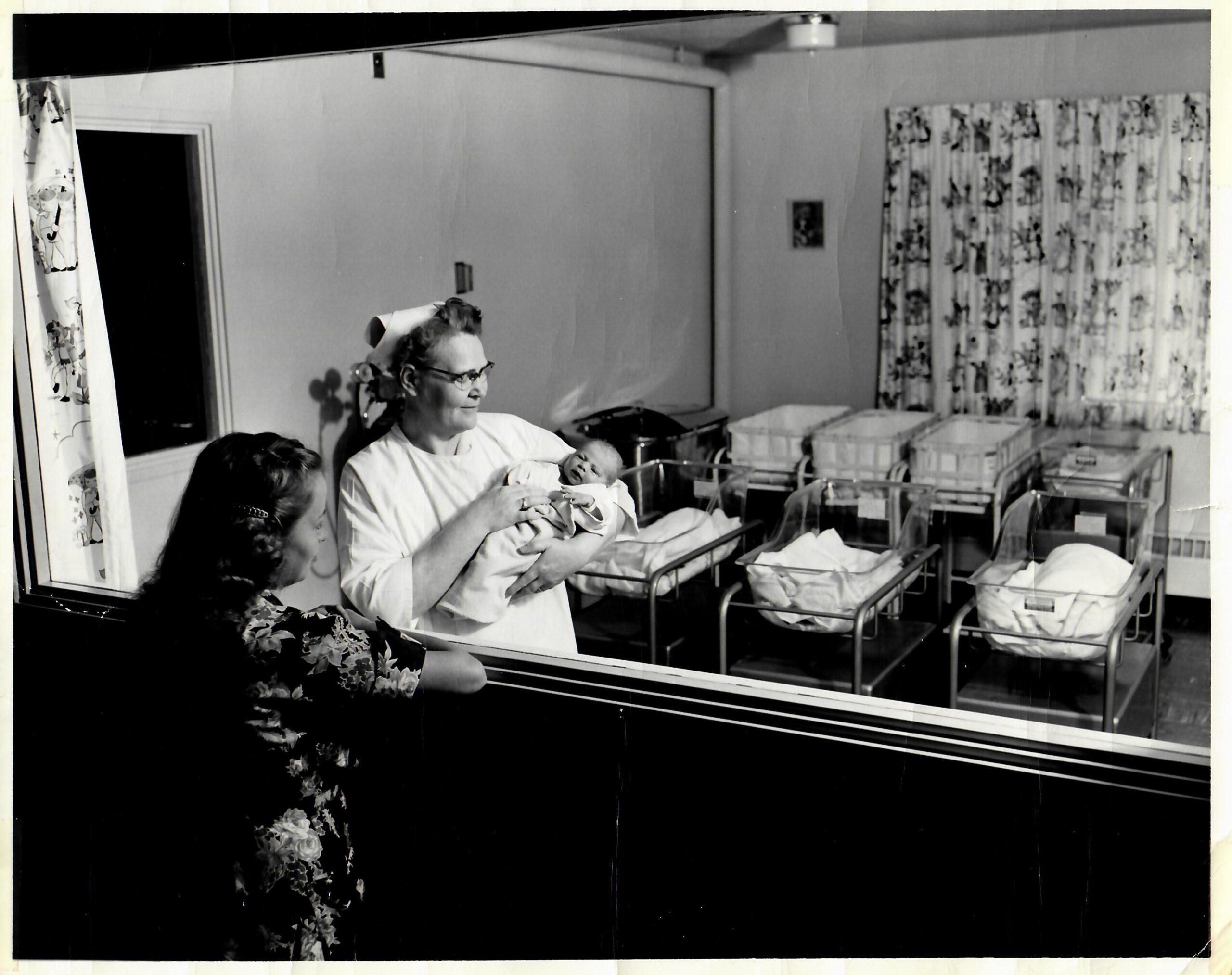 Nurse Ruth Zimmerman with newborn baby, 1954